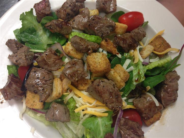 salad with beef, cheese and croutons