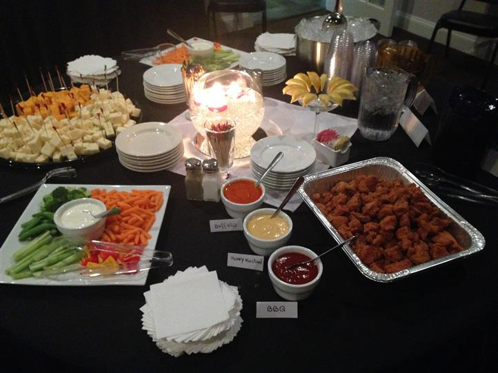 table setting with assorted buffet style trays and sauces