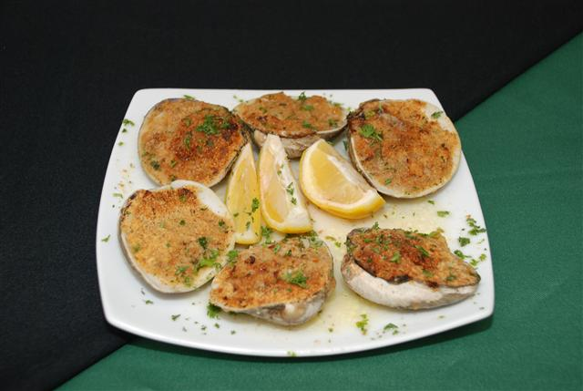 Stuffed clam shells with lemon slices