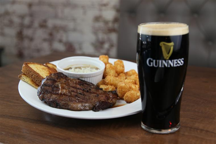 Prime rib with Guinness pint.