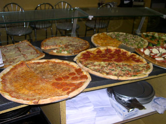 Variety of pizzas on trays