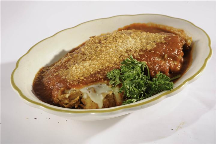 Chicken Parmigiano with sauce in a bowl