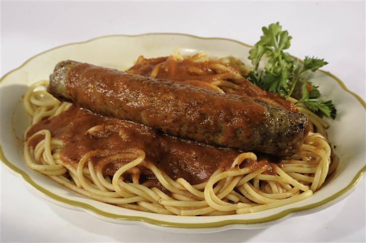 spaghetti with marinara sauce and a piece of sausage