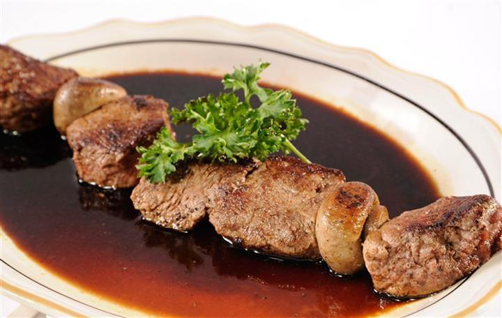 Beef Brochettes with sauce on a plate