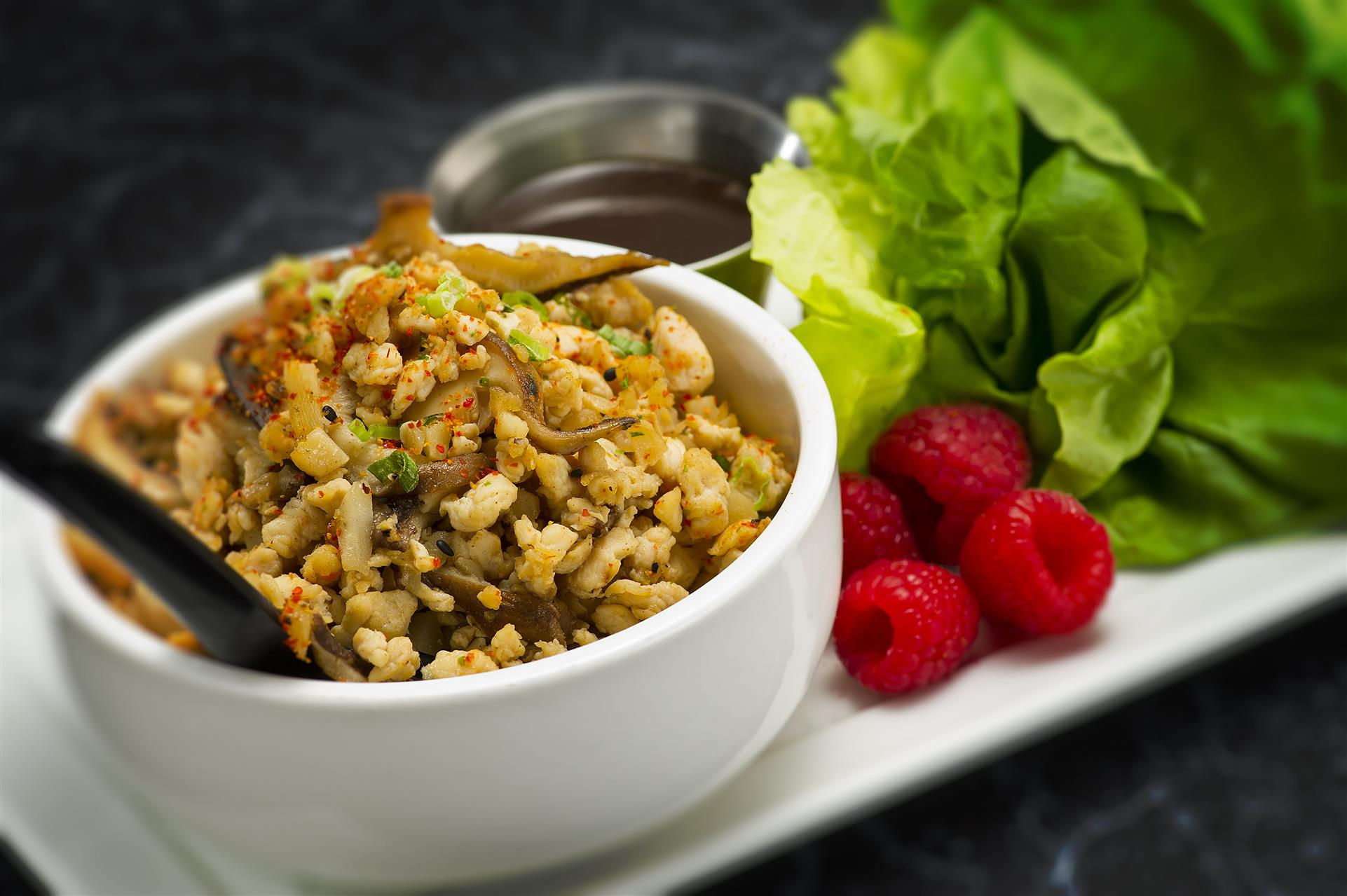 spiced rice with fish mixed in served with a brown sauce