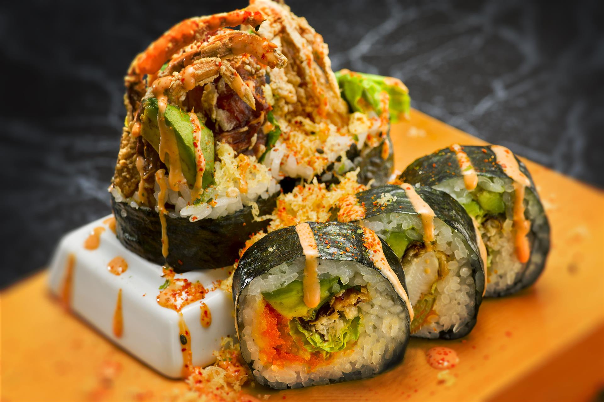 sushi roll with crab tempura, avocado, and spicy mayo