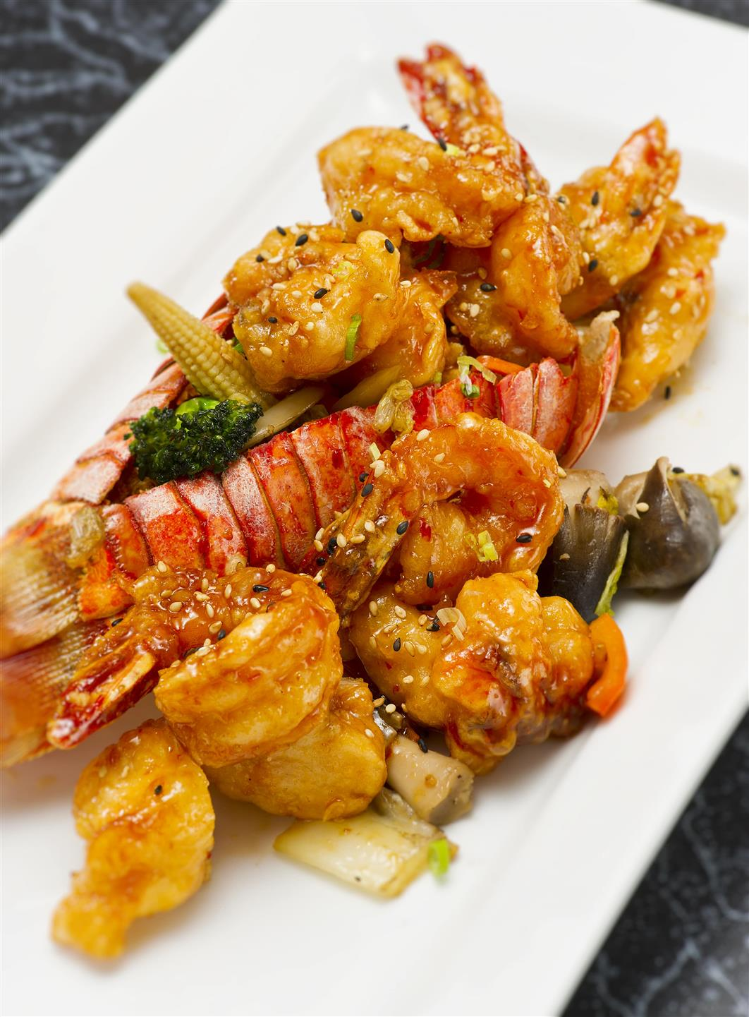 bangbang shrimp and lobster stuffed into a lobster tail serced with veggies