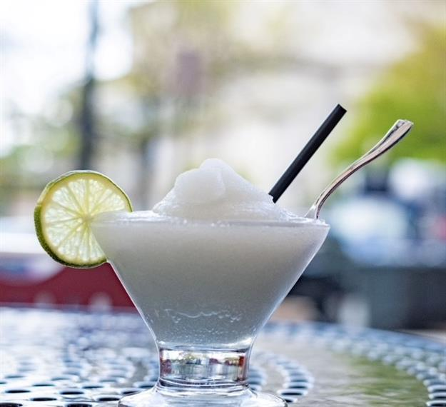 frozen martini with a lime wedge