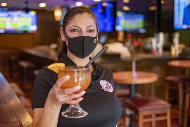 waitress holding a cocktail