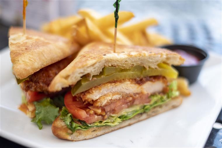 sandwich with fries and dipping sauce