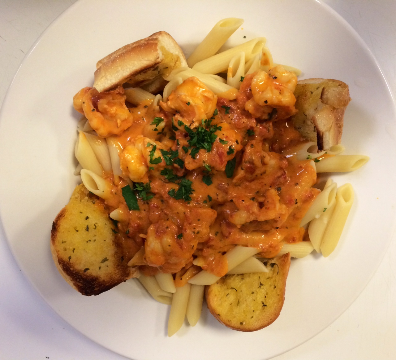 penne pasta with homemade vodka sauce and garlic bread