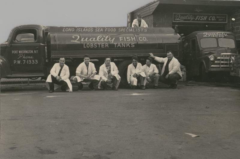 vintage photo of workers in front of lobster tank truck