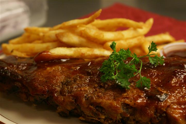 BBQ meat with french fries on the side