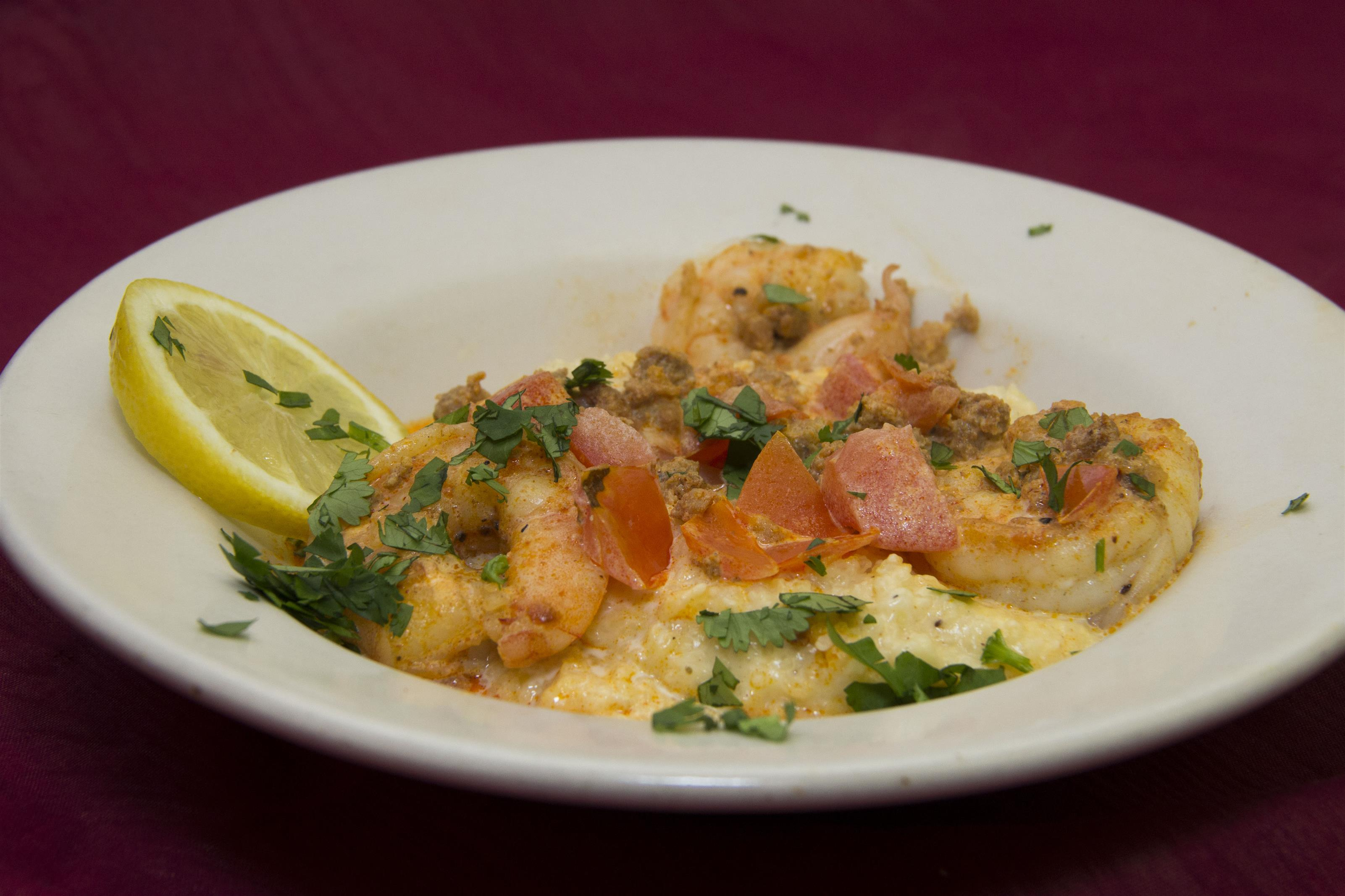 three egg scramble with tomatoes, shrimp and cheese