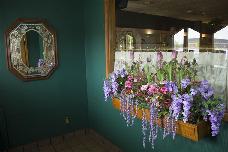 Front side of TJ's Of Calverton Restaurant with floral decor