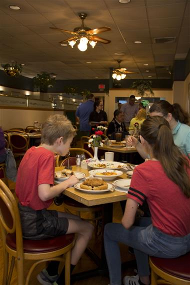 customers at their tables in the dining room