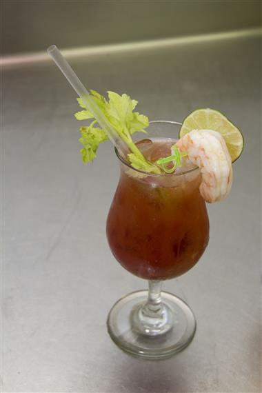 bloody mary garnished with shrimp