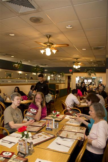 Inside of TJ's Of Calverton Restaurant with customers sitting at all the tables