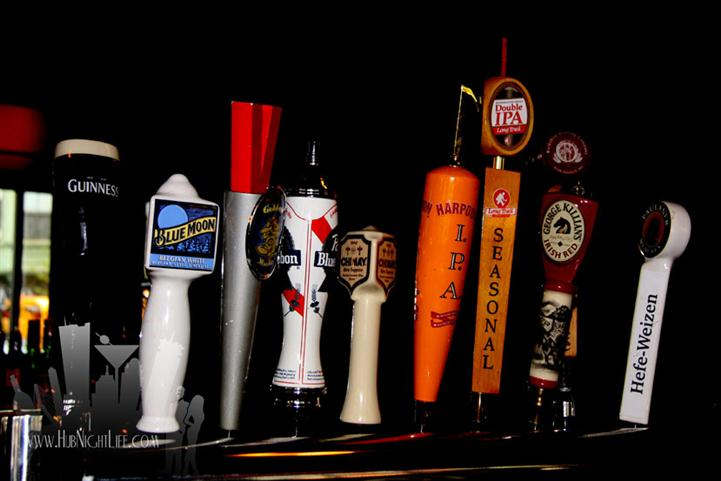 Beer tap handles on the bar counter