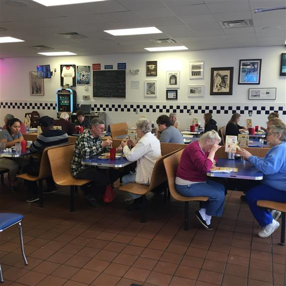 people sitting inside bob and ediths diner dining