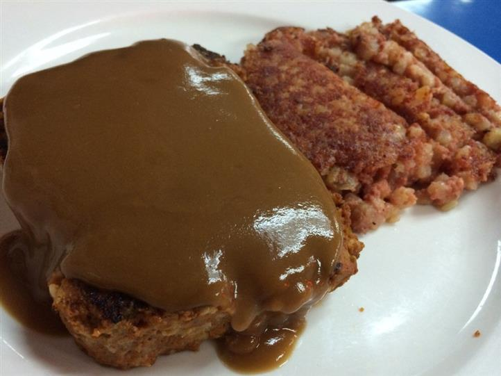 Gravy on slice of bread, side of hash browns