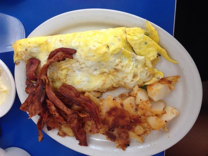 Omelette with side of bacon and home fries