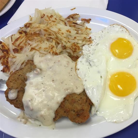 Country fried steak and eggs with hashbrowns