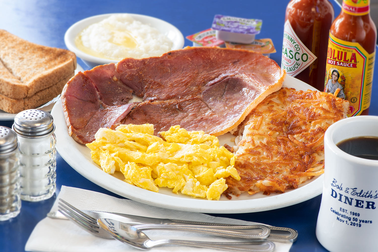 Country Ham with eggs, hashbrowns and grits