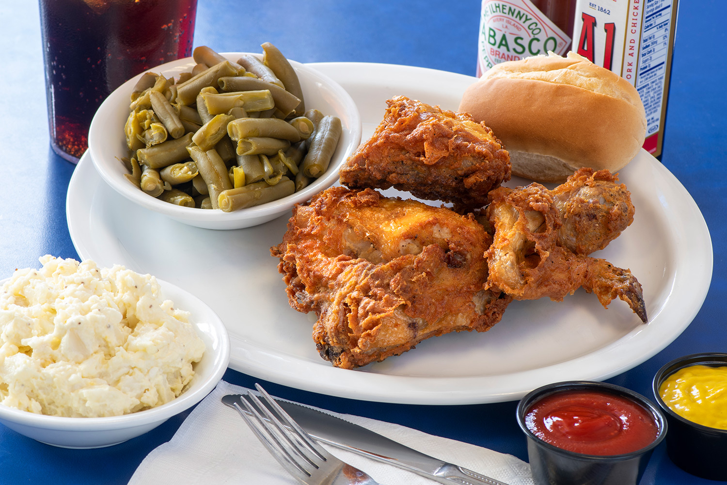 Fried Chicken with string beans and rolls mashed potatoes