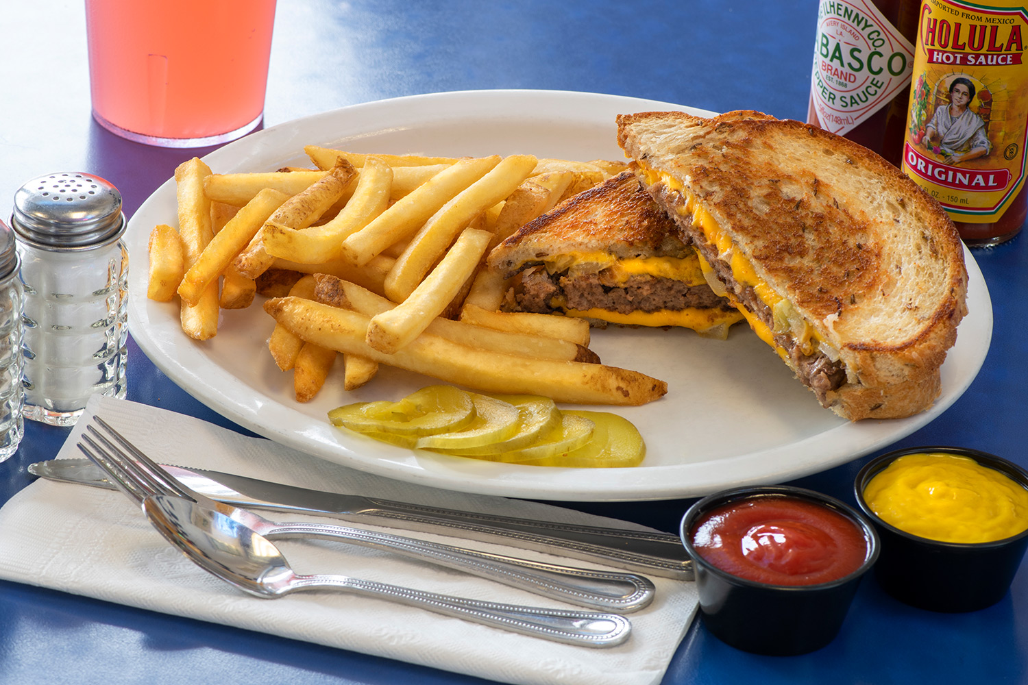 Patty Melt with french fries and pickles