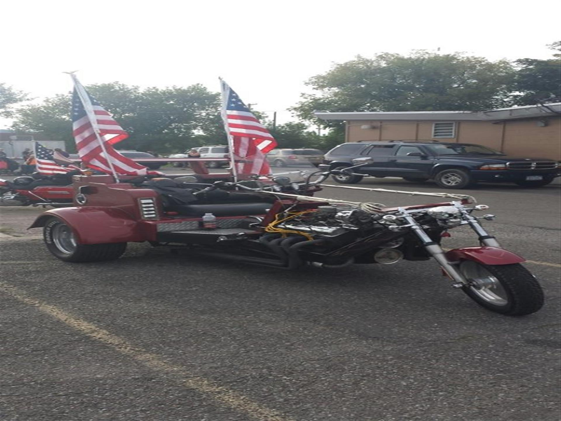Long motorcycle with American flags