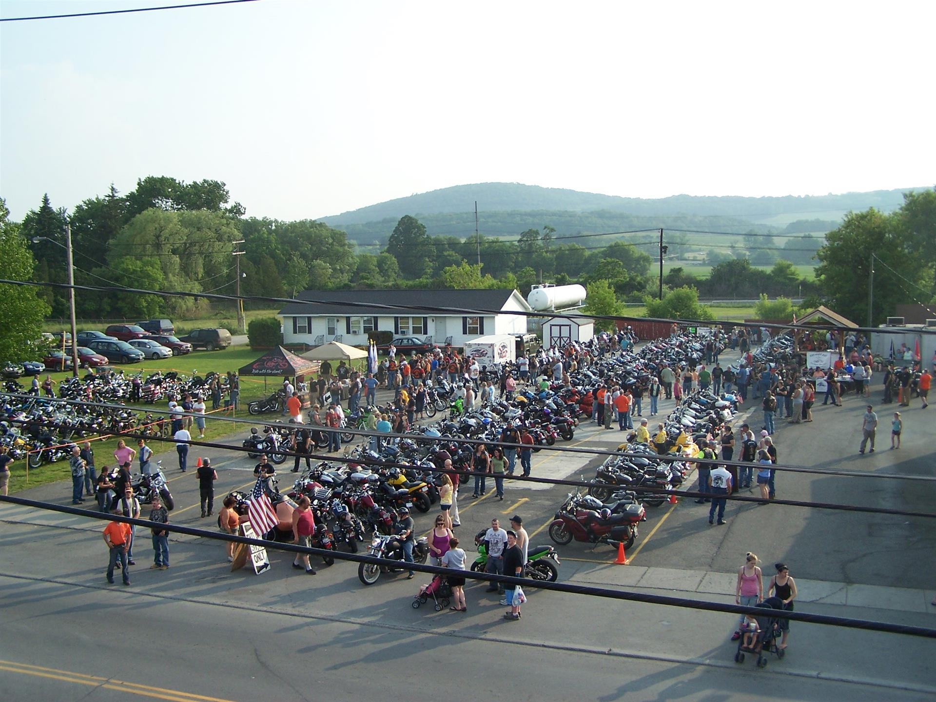 Aerial view of parking lot filled with motorcycles