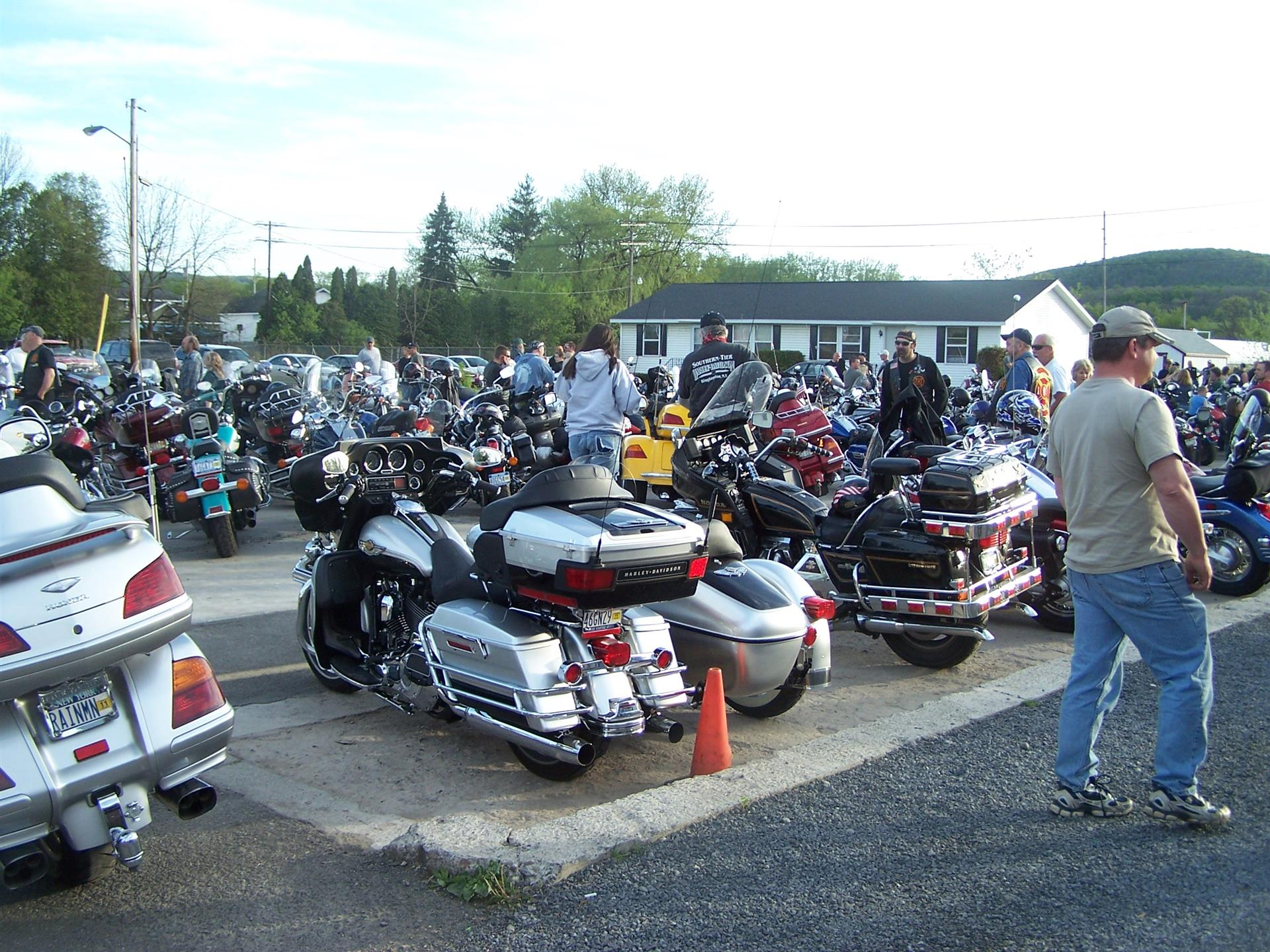 Many motorcycles in parking lot