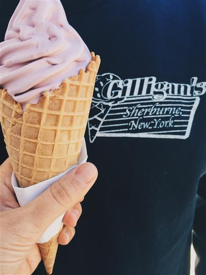 strawberry ice cream cone infront of a shirt with Gilligan's logo