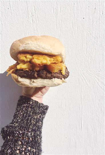 a burger with mac and cheese
