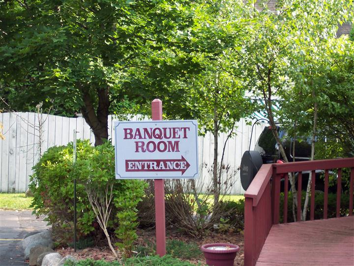 Banquet Room entrance sign located outside of establishment