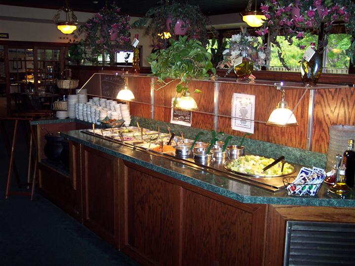salad bar station with variety of toppings