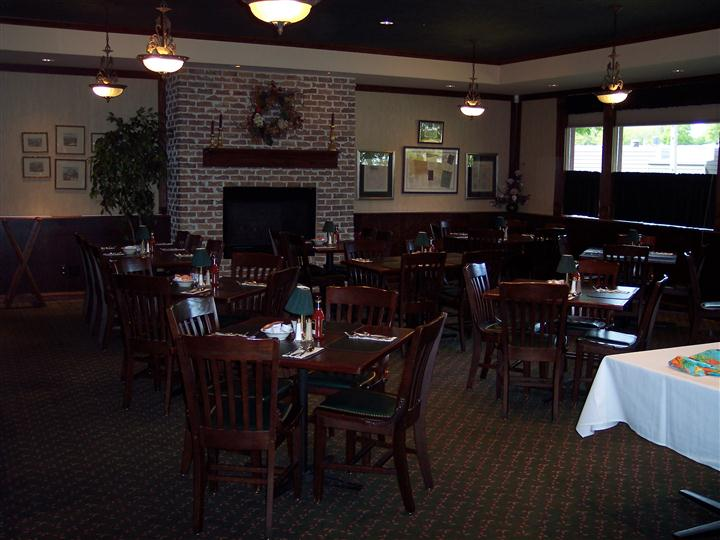 Inside of dining area showing tables of 4 seats with no guests