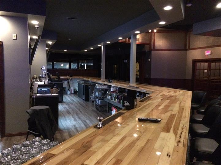 View of bar and behind the bar area.