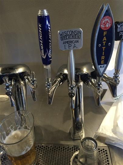 Image of beer tap for Bud Light and Fat Tire.