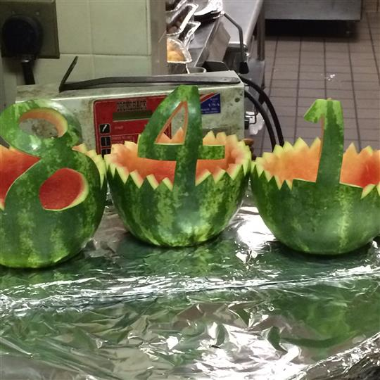 Three watermelons carved out, each with one number to spell out 841.