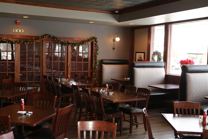 Indoor image of dining area with garland around the door frame.