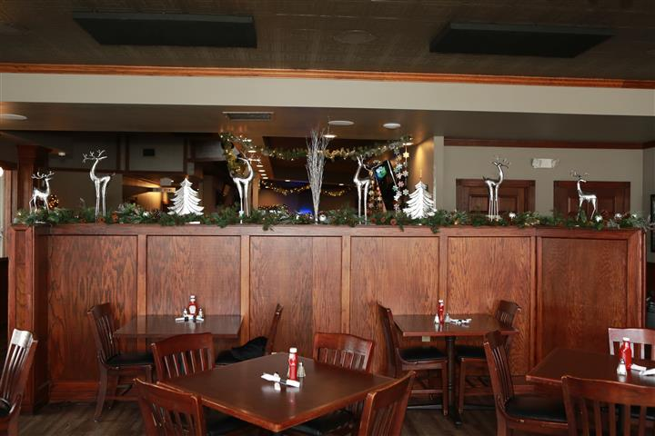 Inside of restaurant with winter decorations and garland.