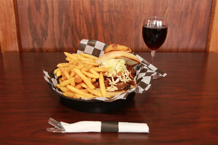 Brew House Specialty Sandwich topped with coleslaw with a side of french fries. Served with a red martini with a glass of red wine.
