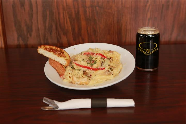 LaBella pasta with two pieces of bread and a dark beer.