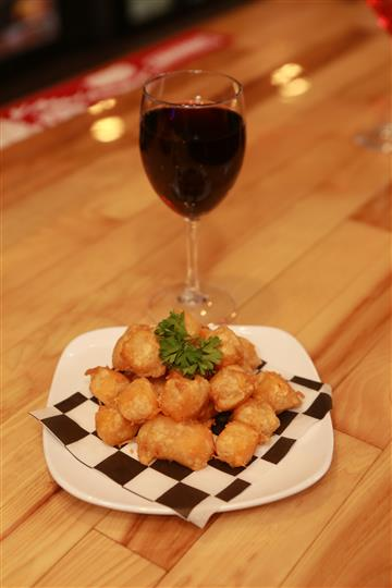 Colby Cheese Curds with a red martini with a glass of red wine.