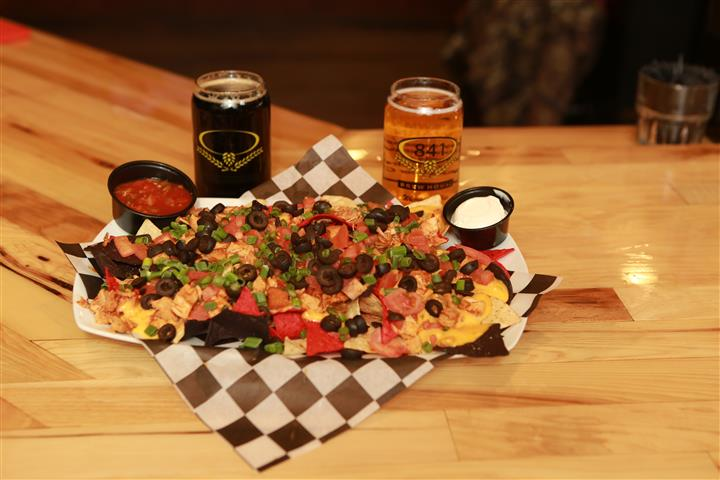 Tatchos with a dark and light beer.