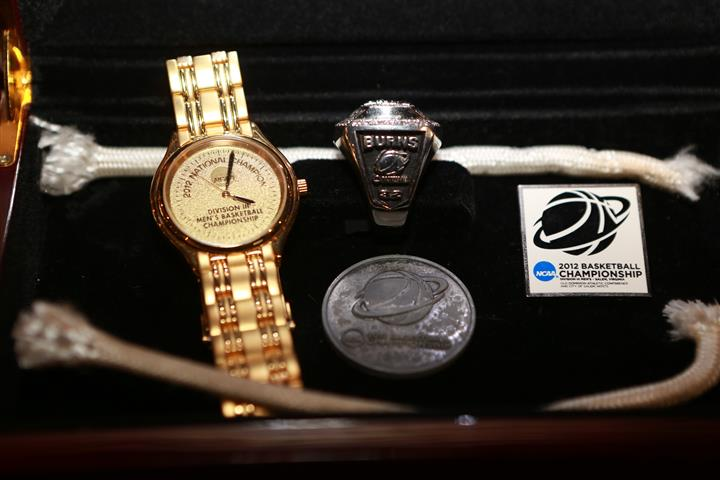 Close up of University of Wisconsin Basketball Champions  memorabilia box with a watch and ring inside.