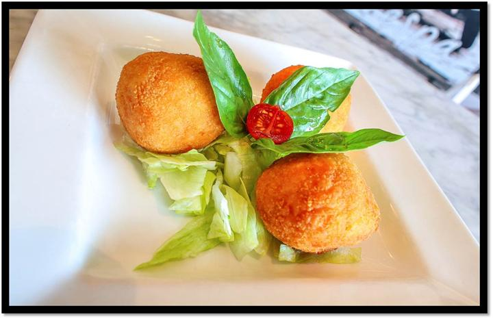fried balls with basil leaves