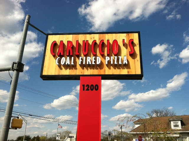 exterior signage for carluccio's coal fired pizza